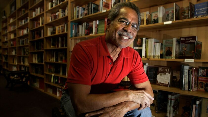 Rueben Martinez, in his bookstore in 2004, started out selling books in Santa Ana his barbershop.