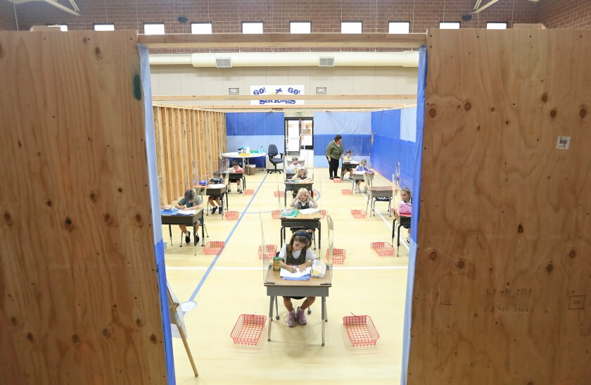 Students work inside a makeshift classroom  at St. Joachim Catholic School in Costa Mesa.