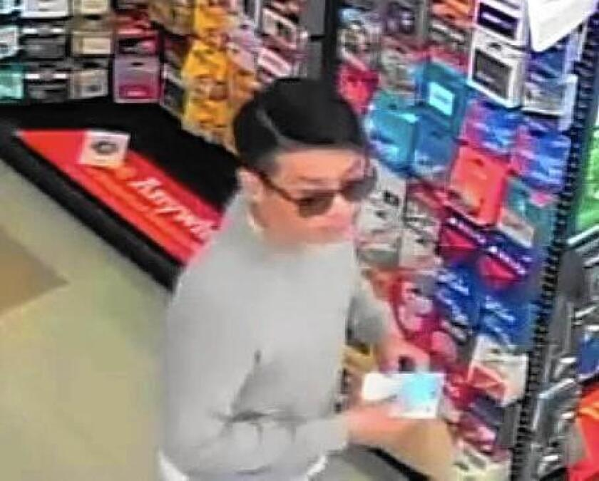 UC Irvine police are looking for this man, who is suspected of using stolen credit cards to make purchases at local businesses.