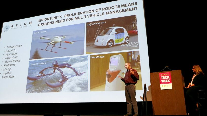 Apium's CEO Tyler MacCready gives his presentation for a new way of robotic communication at the Glendale Tech Week Pitchfest at the Alex Theater in Glendale, on Oct. 12, 2017.