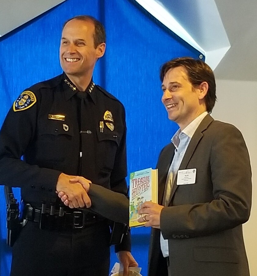 Police Chief David Nisleit shakes hands with Point Loma Rotary Club President Alex Nunes at the meeting's close.