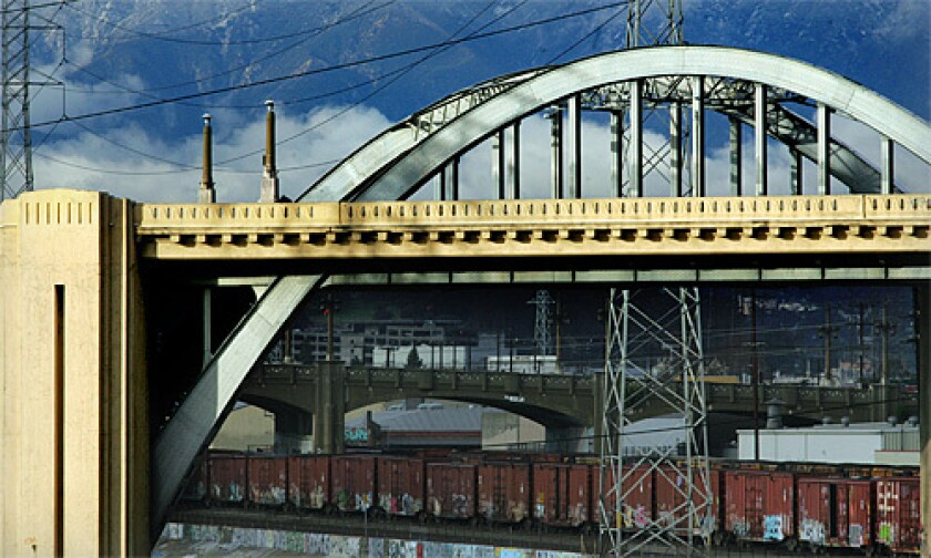 At two-thirds of a mile long, the Sixth Street Viaduct is the largest and longest span along the L.A. River. Known for its two sweeping steel arches and a rather notable curve in the middle, the viaduct is punctuated at either end by decorative pylons with fluted, zigzag designs. Railroad tracks run underneath on both banks of the river. More photos >>>