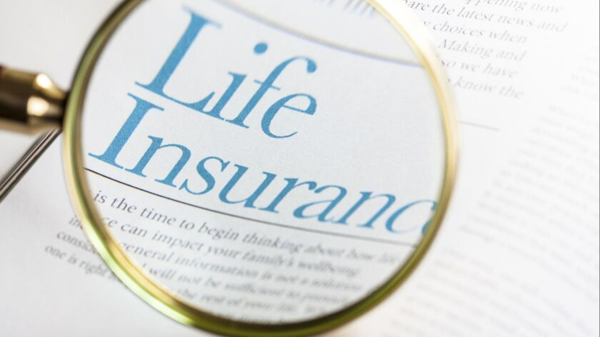 Life Insurance, magnifying glass on papers, by -Oxford-, Getty photo ** OUTS - ELSENT and FPG - OUTS