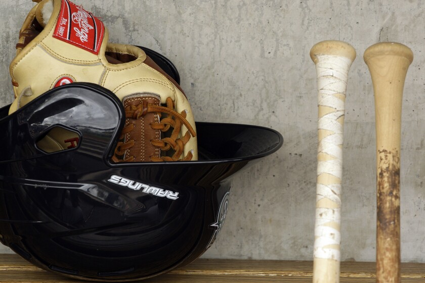 Baseball equipment in a dugout.