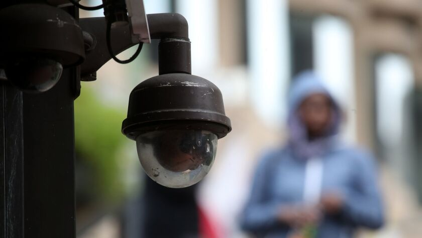 A video surveillance camera hangs from the side of a building in San Francisco, which became the first city in the United States to ban facial recognition technology by police and city agencies.