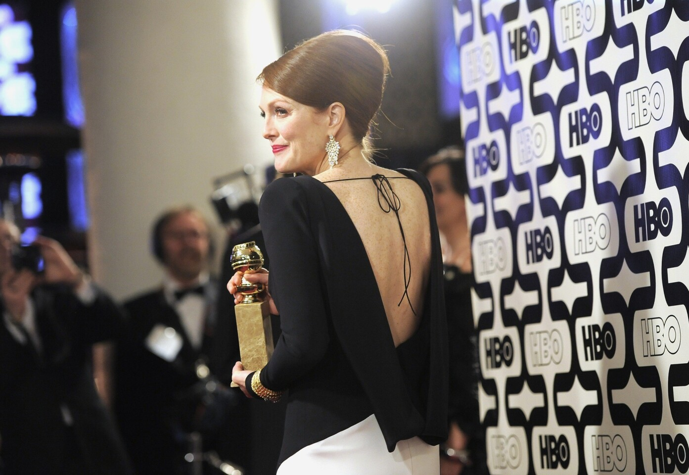"Julianne Moore, winner of the Globe for actress in a miniseries or TV movie for playing Sarah Palin in ""Game Change."""