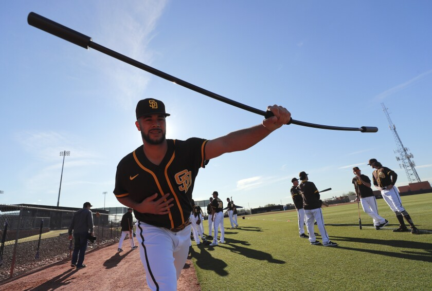 Joey Lucchesi stretches before throwing during spring training.