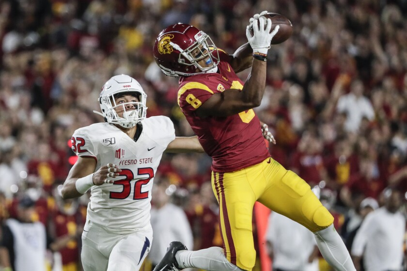 USC receiver Amon-Ra St. Brown hauls in a long pass against Fresno State at the Coliseum on Aug. 31.