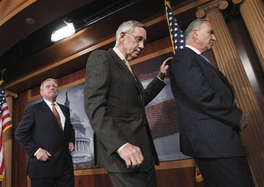 Having insisted there is too much to do for lawmakers to spend a week away from the Capitol, Senate Majority Leader Harry Reid of Nev., center, walks with Senate Majority Whip Richard Durbin of Ill., left, and Sen. Charles Schumer, D-N.Y., after a news conference on Capitol Hill in Washington, Thur