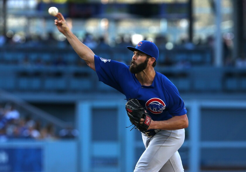 Cubs starting pitcher Jake Arrieta delivers against the Dodgers at Dodger Stadium on Aug. 30.