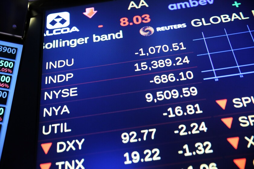 A screen on the floor of the New York Stock Exchange shows the the Dow Jones industrial average briefly dropping more than 1,000 points in morning trading on Aug. 24.