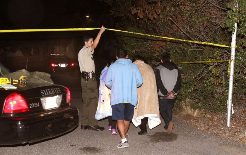 A county Sheriff's Department Explorer allowed residents access to a cul-de-sac on Granite Road near Palomar College after one man was shot and killed and his brother was arrested Sunday night.