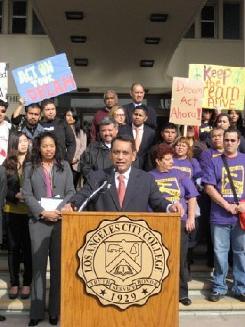 Los Angeles Assemblyman Gil Cedillo talks to students about the set of laws he championed to allow undocumented students apply for private and public funding for college. Both laws were signed last year by Governor Jerry Brown.