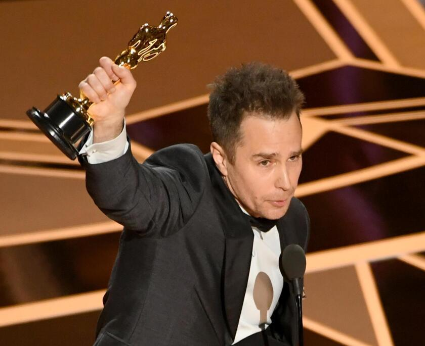 HOLLYWOOD, CA - MARCH 04:  Actor Sam Rockwell accepts Best Suppoorting Actor for 'Three Billboards Outside Ebbing, Missouri' onstage at the 90th Annual Academy Awards at the Dolby Theatre at Hollywood & Highland Center on March 4, 2018 in Hollywood, California.  (Photo by Kevin Winter/Getty Images)
