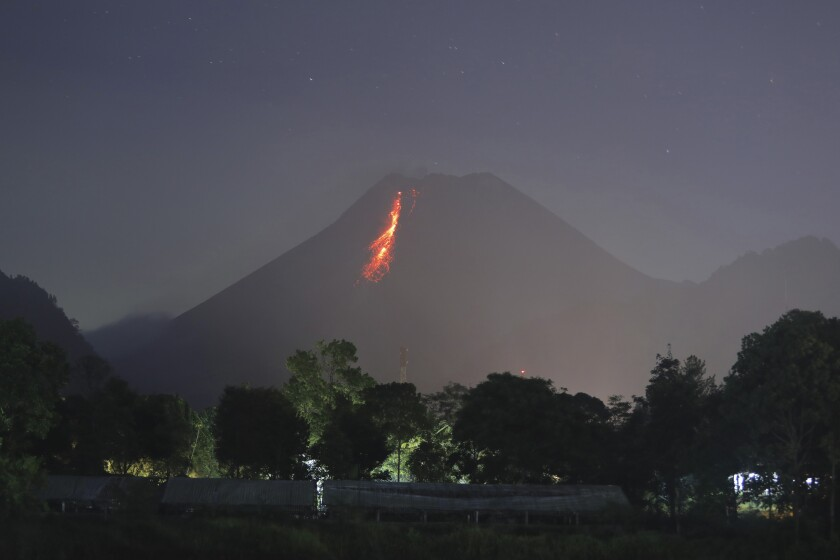 In this time-lapsed photo, hot lava runs down from Mt. Merapi in Kaliurang, Indonesia.