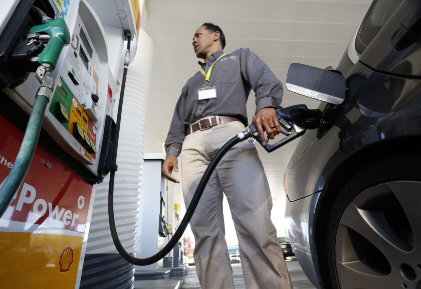 A gallon of regular gasoline averaged $4.196 in California, $4.303 in Los Angeles and $3.657 nationwide Thursday. Above, Eric Henry fills up in Sacramento.