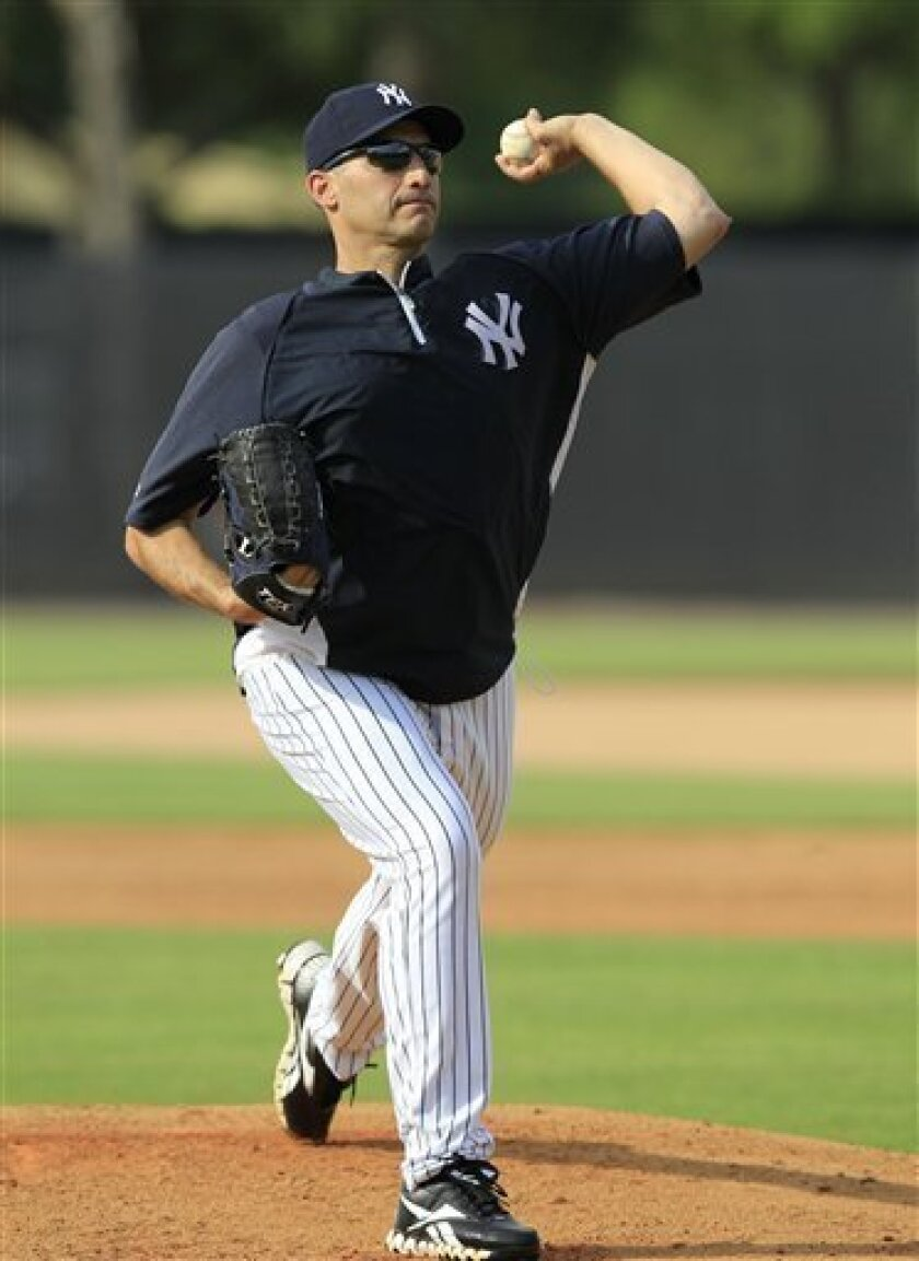 New York Yankees pitcher Andy Pettitte throws from the mound during a drill for pitchers and fielders before a spring training baseball game against the Philadelphia Phillies  at Steinbrenner Field in Tampa, Fla., Friday, March 30, 2012.  (AP Photo/Kathy Willens)