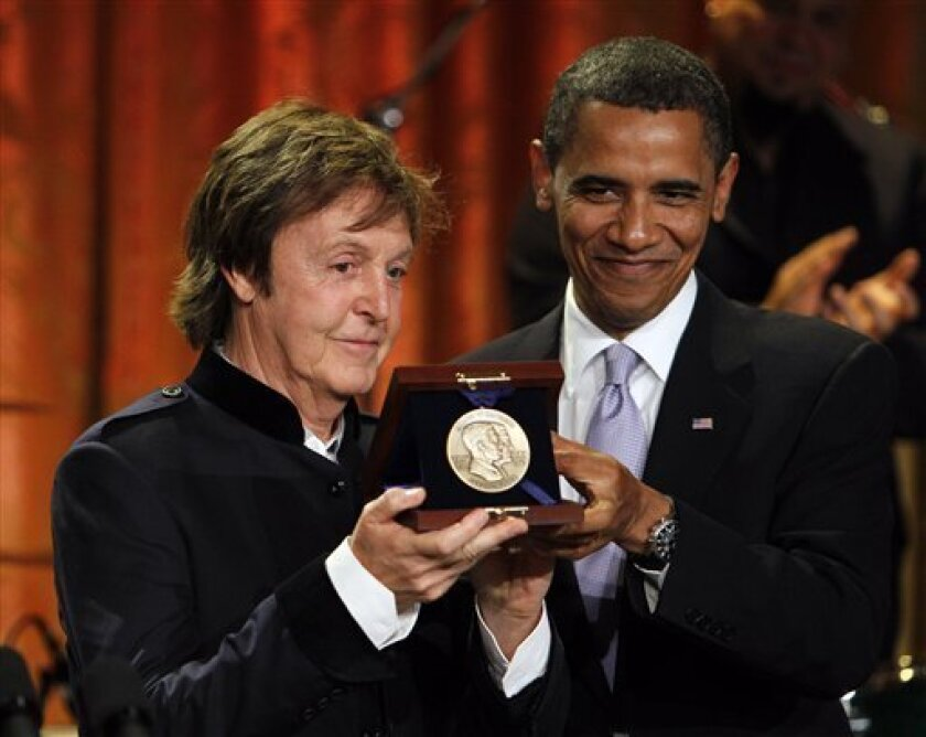 President Barack Obama, right, presents Paul McCartney with the Gershwin Prize for Popular Song in the East Room of the White House in Washington, Wednesday, June 2, 2010. (AP Photo/Alex Brandon)