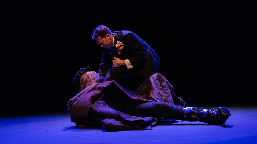 "Tom Vitorino, on the ground, and John Ralston Craig in Thursday Night Theater Club's ""The Elephant Man"" at El Portal Theatre."