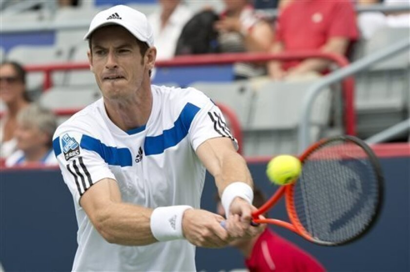 Andy Murray, from Great Britain, returns the ball to Marcel Granollers, from Spain, during the Rogers Cup men's tennis tournament in Montreal on Wednesday, Aug. 7, 2013. (AP Photo/The Canadian Press, Paul Chiasson)