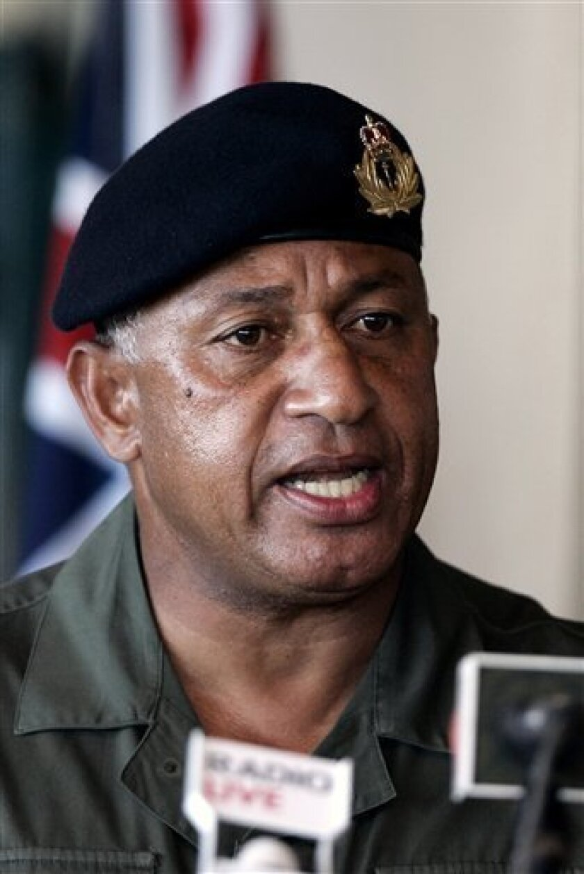 FILE - In this file photo taken Dec. 6, 2006, Fijian military Commodore Frank Bainimarama speaks at a ceremony at the main military barracks in Suva. Fiji's military ruler defied international pressure to announce elections by Friday, May 1, 2009, confirming that he would not hold them for at least five years and setting the stage for his country's ouster from a South Pacific bloc. (AP Photo/Rick Rycroft, File)