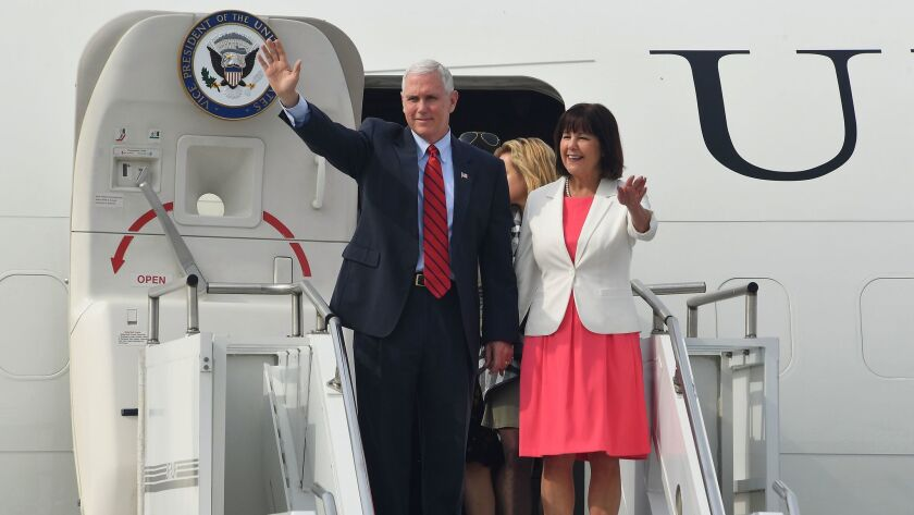 Vice President Mike Pence and his wife, Karen, arrive at Osan airbase in Seoul on Sunday.