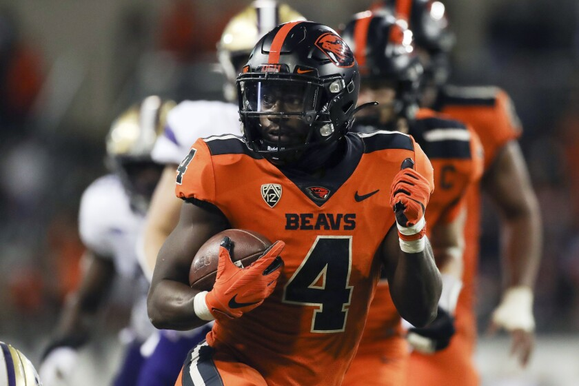 Oregon State running back B.J. Baylor (4) rushes for 27-yards to score a touchdown during the second half of an NCAA college football game against Washington on Saturday, Oct. 2, 2021, in Corvallis, Ore. Oregon State won 27-24. (AP Photo/Amanda Loman)