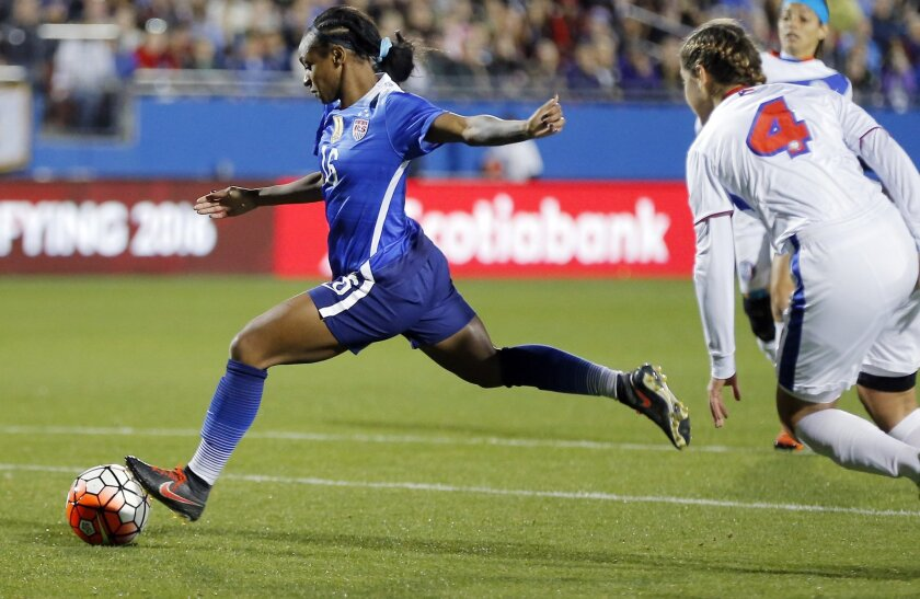 United States forward Crystal Dunn (16) attempts a shot on goal as Puerto Rico midfielder Viviana Fiol Vilches (4) defends during the first half of a women's Olympic qualifying soccer match, Monday, Feb. 15, 2016 in Frisco, Texas. (AP Photo/Brandon Wade)