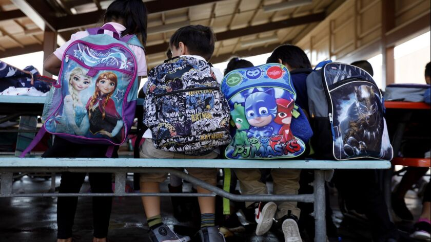 PACOIMA, CA OCTOBER 25, 2018: Students sit at tables after school at Telfair Elementary in Pacoima