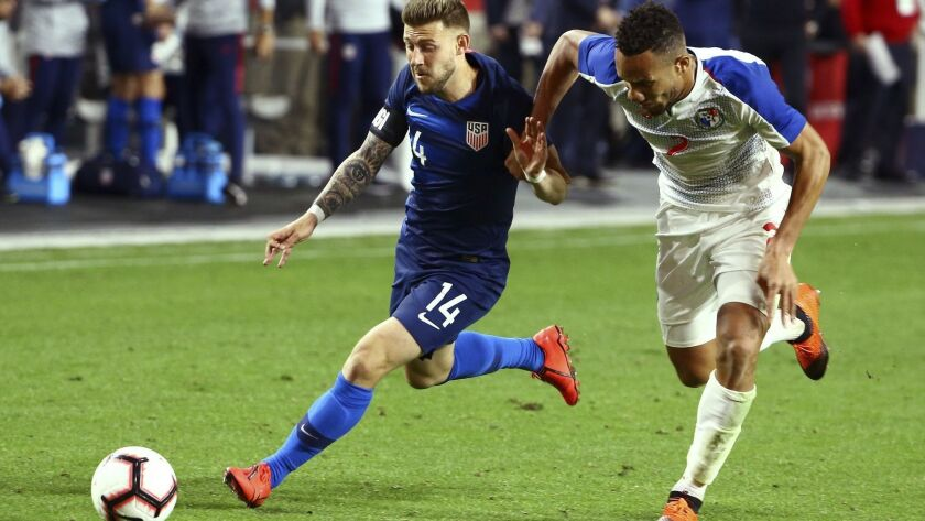 United States midfielder Paul Arriola (14) beats Panama defender Francisco Palacios to the ball during the second half of a men's international friendly soccer match on Sunday in Glendale, Ariz.