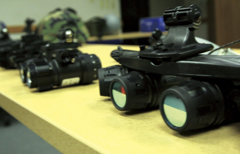 Night vision equipment, including the Ground Panoramic Night Vision Goggle-18 (GPNVG-18), at right. Yang Xin, a Chinese national, is accused of trying to buy the same type of goggles from an undercover agent in San Diego.