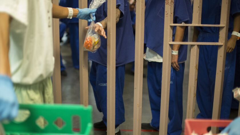 Inmates at the North County Correctional Facility in Castaic in October. An assault charge against Jonathan Grijalva, a former L.A. County sheriff's jail guard, was dismissed last week after prosecutors said they could not locate the man who had been attacked as a witness.