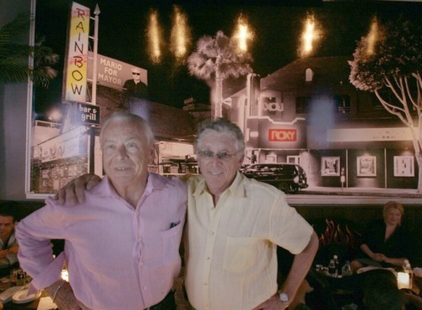 Music industry executive Bob Greenberg, left, with brother Jerry at their restaurant in Las Vegas in 2005. They were partners in the music business as well, with Jerry on the East Coast and Bob on the West Coast for various record labels. Bob Greenberg died Friday.