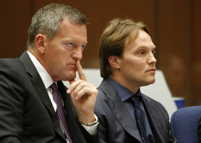 UCLA chemistry professor Patrick Harran, right, sits with his attorney, Thomas O'Brien, in Los Angeles County Superior Court.