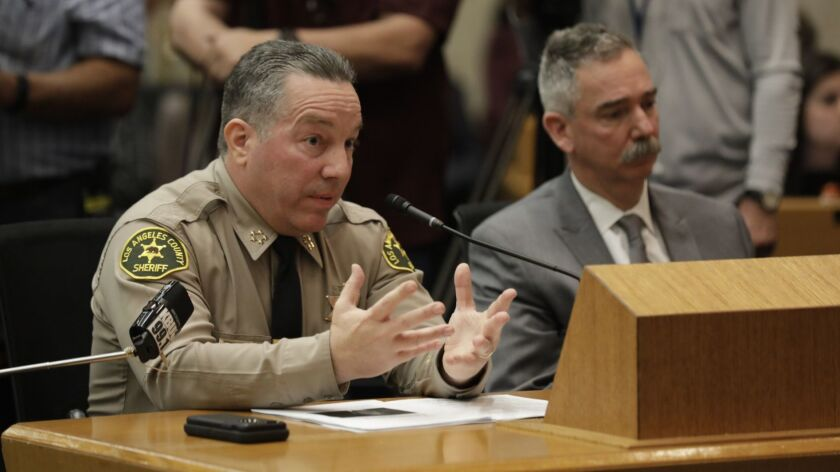 L.A. County Sheriff Alex Villanueva speaks in front of L.A. County Board of Supervisors about his controversial reinstatement of a deputy who volunteered on his campaign and who had been fired in connection with allegations of domestic violence.