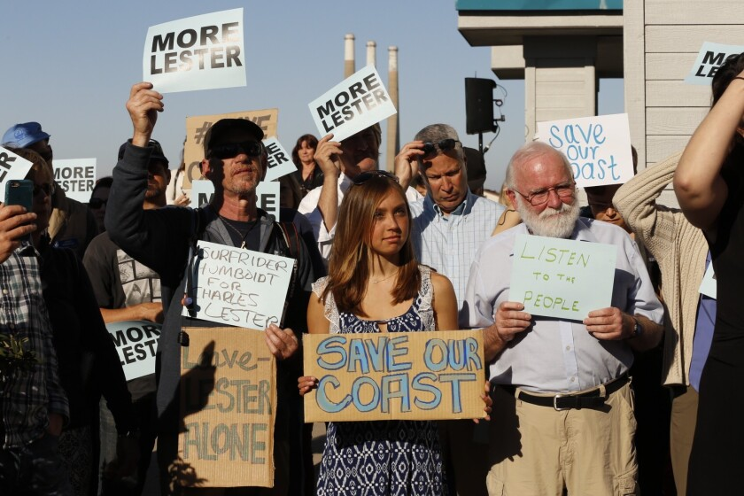 Protestors meet to support Charles Lester before the start of the California Coastal Commission meeting Wednesday morning.