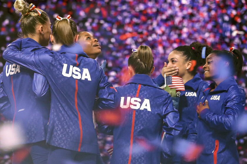 US female Olympic gymnasts in a scene from
