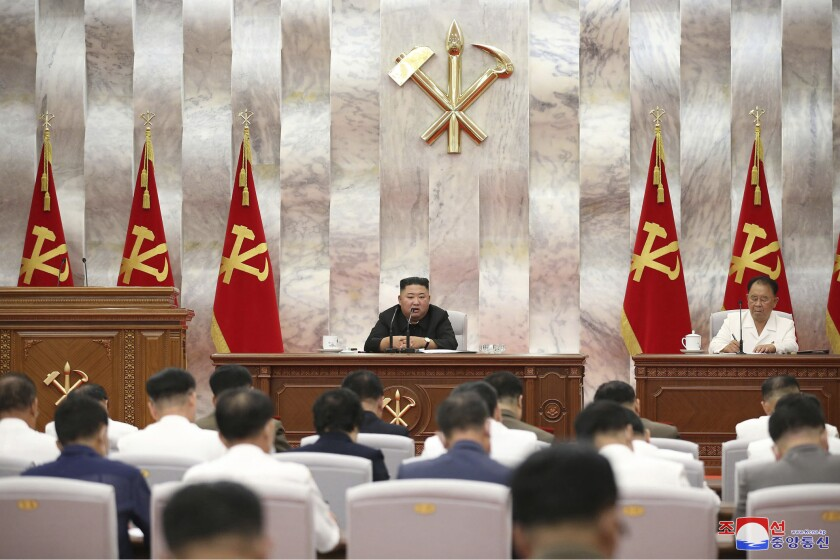 """In this photo provided by the North Korean government, North Korea leader Kim Jong Un speaks during a Workers' Party meeting in Pyongyang, North Korea, Tuesday, Sept. 8, 2020. Kim during the high-level political conference called for urgent efforts to rebuild thousands of homes and other structures destroyed by Typhoon Maysak that slammed the country's eastern region last week, state media said Wednesday, Sept. 9. Independent journalists were not given access to cover the event depicted in this image distributed by the North Korean government. The content of this image is as provided and cannot be independently verified. Korean language watermark on image as provided by source reads: """"KCNA"""" which is the abbreviation for Korean Central News Agency. (Korean Central News Agency/Korea News Service via AP)"""