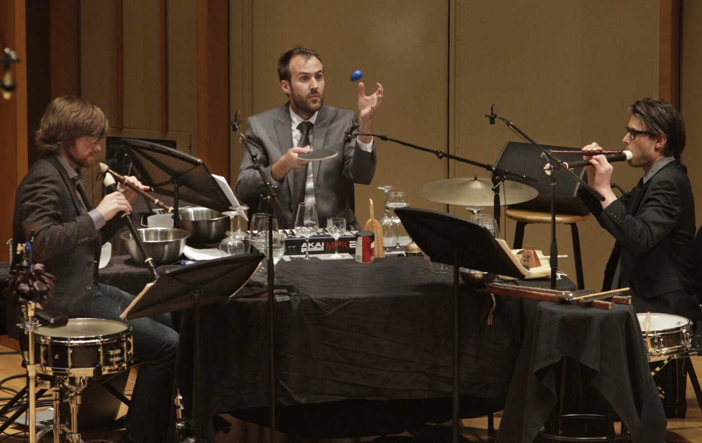 """Percussionists Ryan Nestor, left, Eric Derr and Jonathan Hepfer of the Echoi Ensemble performing Thomas Meadowcroft's """"The Great Knot"""" in New Voices II at the Zipper Concert Hall at the Colburn School."""