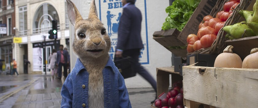 A computer-generated rabbit beside a vegetable stand