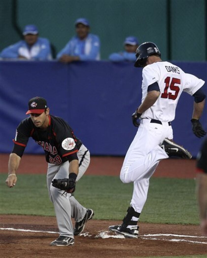 Canada first baseman Jimmy Van Ostrand, left, gets the force out of United States' Jordan Danks during the first inning of the final baseball game at the Pan American Games in Lagos de Moreno, Mexico, Tuesday Oct. 25, 2011. (AP Photo/Javier Galeano)