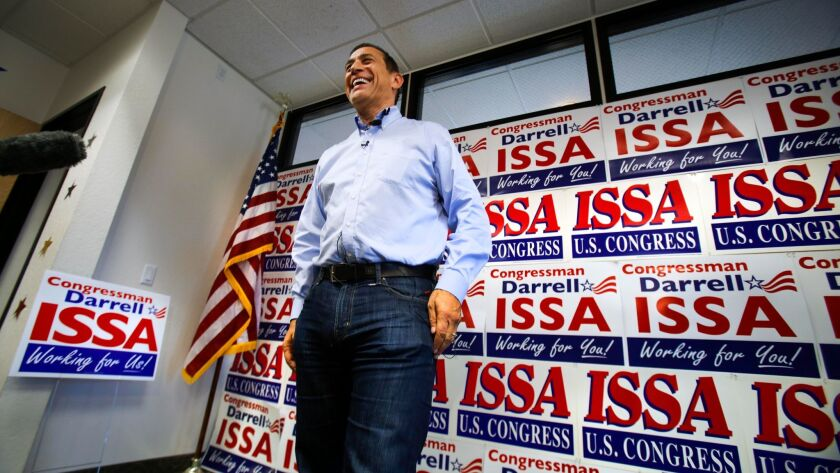 Congressman Darrell Issa answers reporters questions at his Oceanside campaign headquarters.
