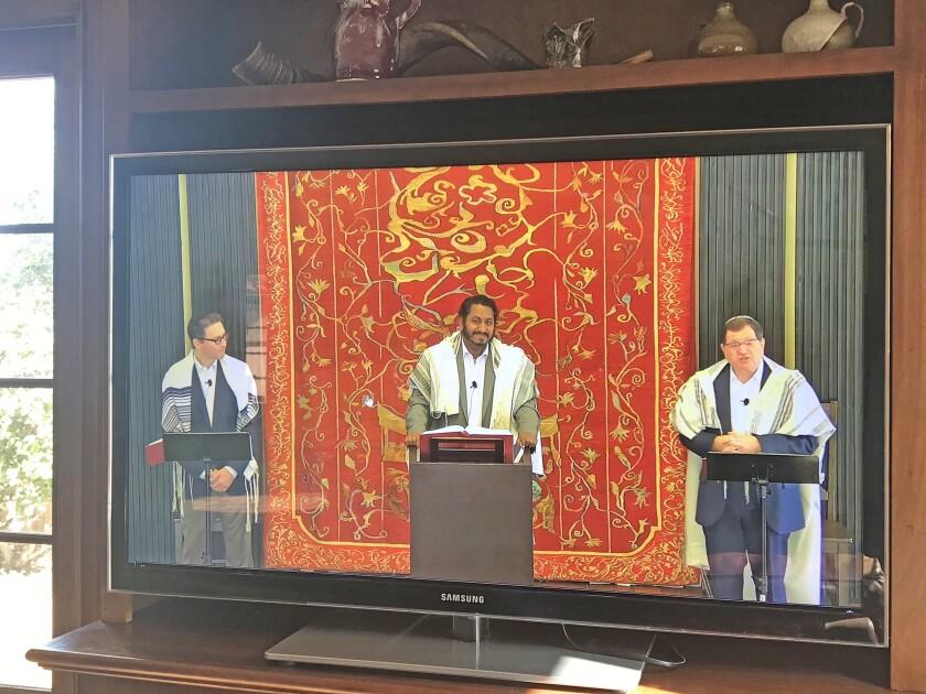 Rabbi Avi Libman, prayer-leader David Lipsitz and Rabbi Ron Shulman live-stream a morning Shabbat service from Stone Family Sanctuary at Congregation Beth El to its website: cbe.org — as seen in March 2020 amid the coronavirus climate.