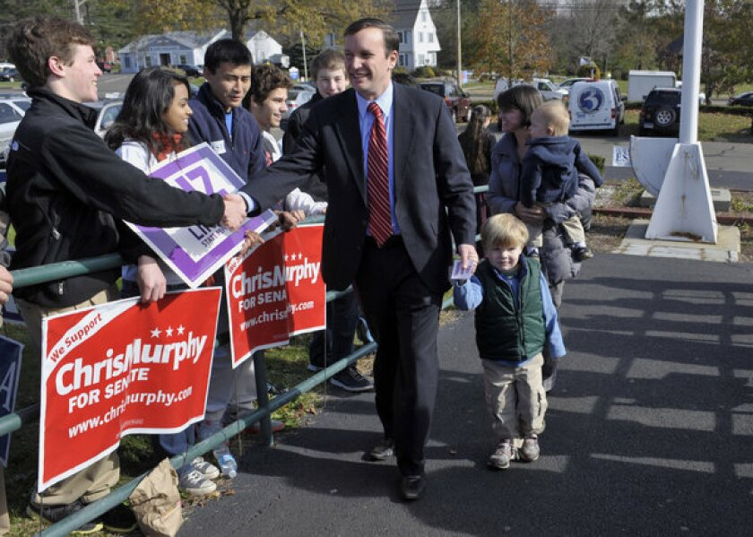 Democratic U.S. Senate candidate Chris Murphy arrives with his family to vote in Cheshire, Conn.