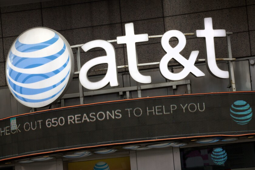 """FILE - In this Oct. 24, 2016, file photo, the AT&T logo is positioned above one of its retail stores, in New York. A Pakistan resident has been sentenced on Thursday, Sept. 16, 2021, to 12 years in prison for a conspiracy to """"unlock"""" phones from AT&T's network, a scheme the company says cost it more than $200 million. Muhammad Fahd, 35, of Karachi, recruited an employee of an AT&T call center in Bothell, Wash., via Facebook in 2012, and began bribing that employee and his coworkers to use their credentials to unlock phones. (AP Photo/Mark Lennihan, File)"""