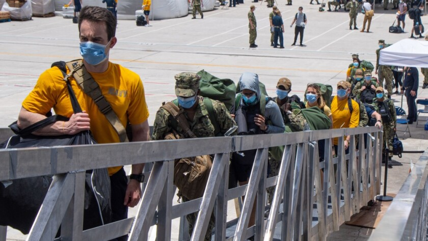 U.S. Navy Sailors assigned to the aircraft carrier USS Theodore Roosevelt (CVN 71) board the ship May 2, 2020.