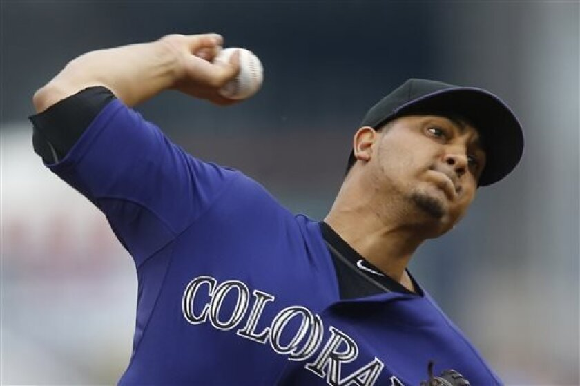 Colorado Rockies' Jhoulys Chacin throws against the Pittsburgh Pirates in the first inning of the baseball game on Friday, Aug. 2, 2013, in Pittsburgh. (AP Photo/Keith Srakocic)