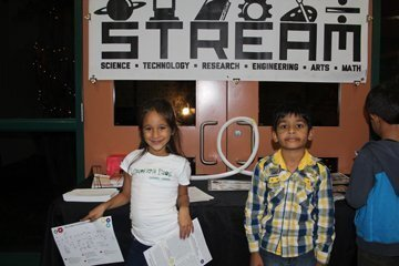 Kayla and Surya welcomed families to STREAM Night.