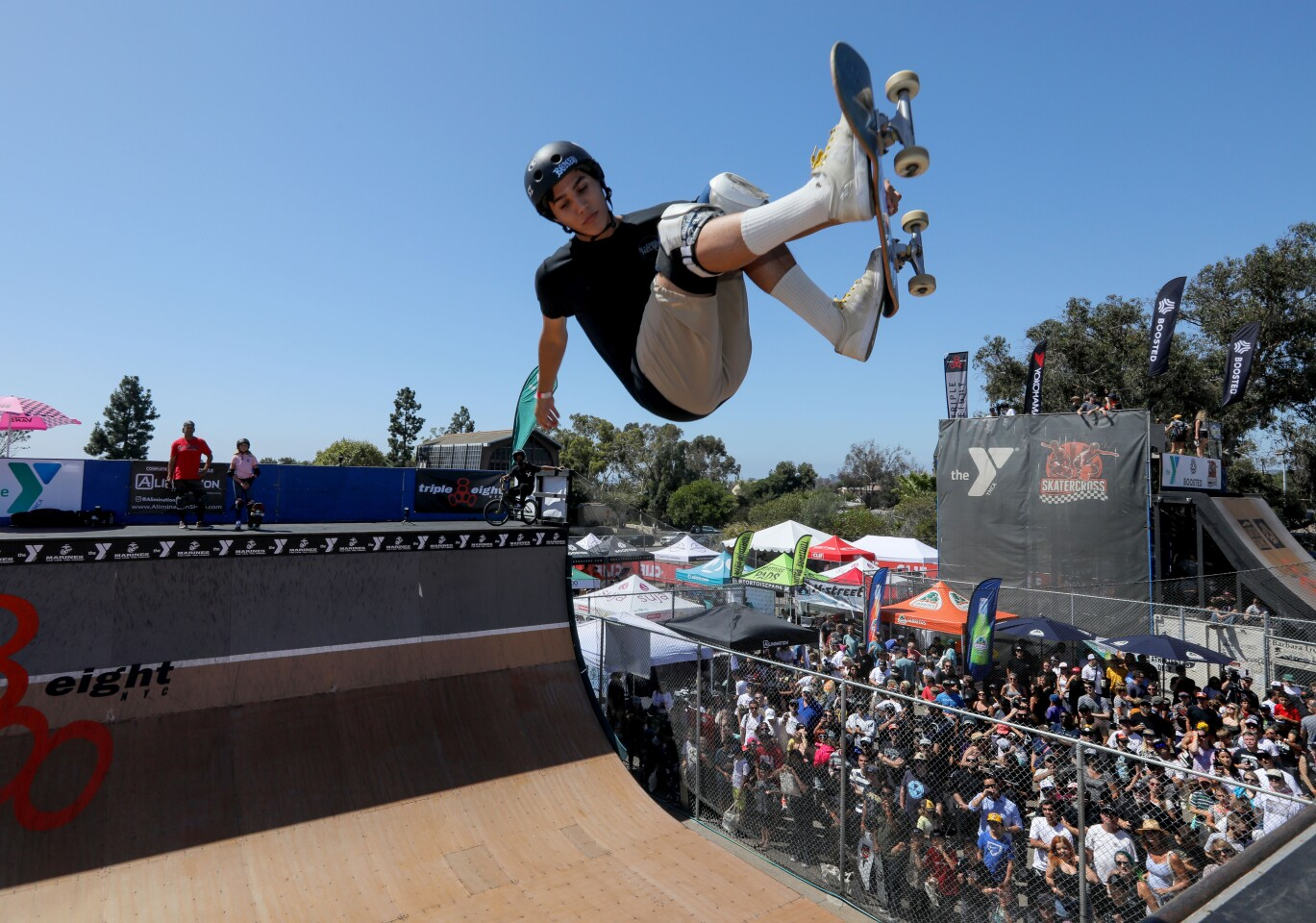 Oceanside's Austin Poynter gets serious air at the Triple Eight Clash at Clairemont skateboard event during the Pro Vert Ramp Jam demonstration.