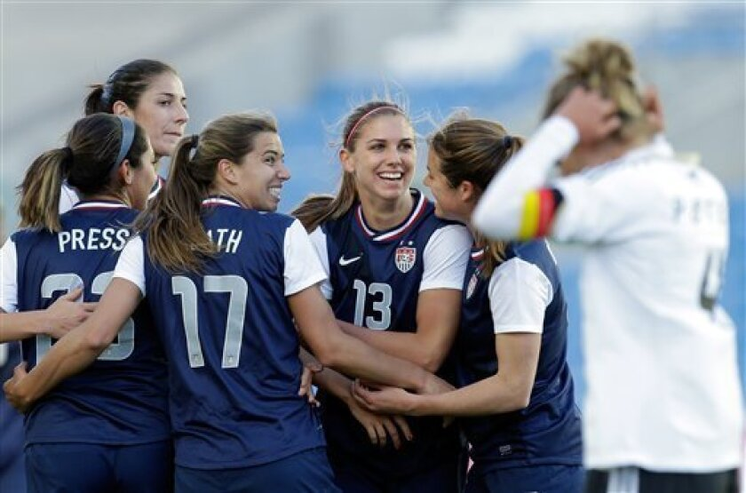 Alex Morgan, 3rd right, of the US, celebrates after scoring the opening goal against Germany during their Algarve Cup women's soccer final match Wednesday, March 13 2013, at the Algarve stadium outside Faro, southern Portugal. (AP Photo/Armando Franca)